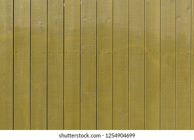 Background from an olive green plank wall