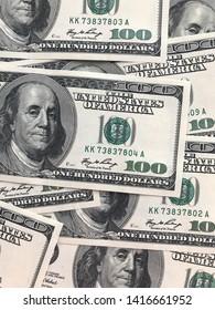 background of one hundred dollar cash bills