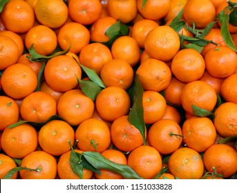 background of orange mandarins from Sicily for sale at the fruit and vegetable market