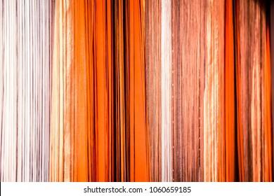 background of orange thread curtains