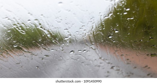 the background is out of focus. view from the window of a car in the rain