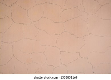 Background, painted wall plaster. The texture of the surface of the outer wall of the building.