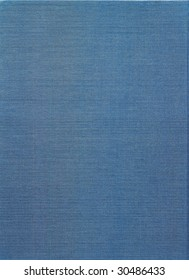 Background of pale blue canvas with coarse texture.
