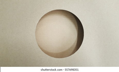 The background paper is a circular hole./packing paper