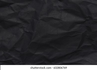 The background paper, crumpled black