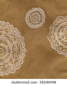 Background paper with a painted white lace. Kraft paper texture