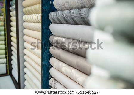 background paper rolls on wall shop stock photo edit now 561640627