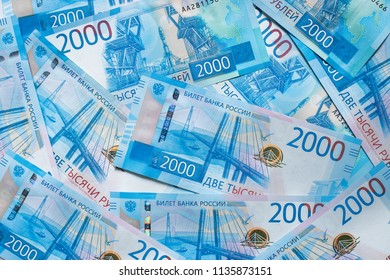 Background Of Paper Russian Money. New Russian Banknotes Of 2000 Two Thousands Rubles Close Up.
