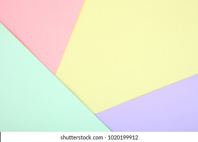 Background of pastel colored paper, geometry. Copy space.