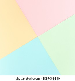 Background pastel colors: pink, yellow, blue, green. Geometric pattern papers. Minimal concept. Flat lay, Top view.