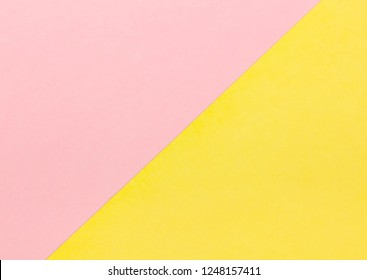 Background with pastel pink and yellow color. Flat Lay.