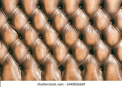 Background pattern of chesterfield buttoned brown leather