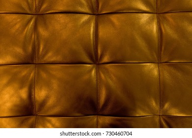 Background Pattern, Closed up of Abstract Texture of Luxury Golden Leather Sofa or Upholstery.