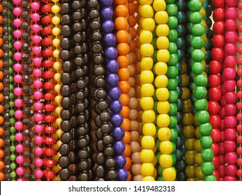 Background pattern of multicolored natural wooden beads.
