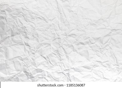 Background or pattern of Wrinkled white rectangular paper with rough texture.