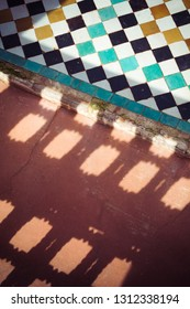 Background with patterned shadows and tiles in Morocco