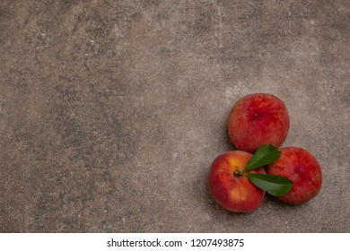 Background with peaches. Peaches - ripe fruits lying on a stone plate. Menu background.
