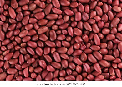 Background of peanut placer bright snacks; close-up