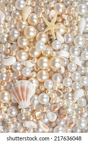background of pearl beads and sea shells