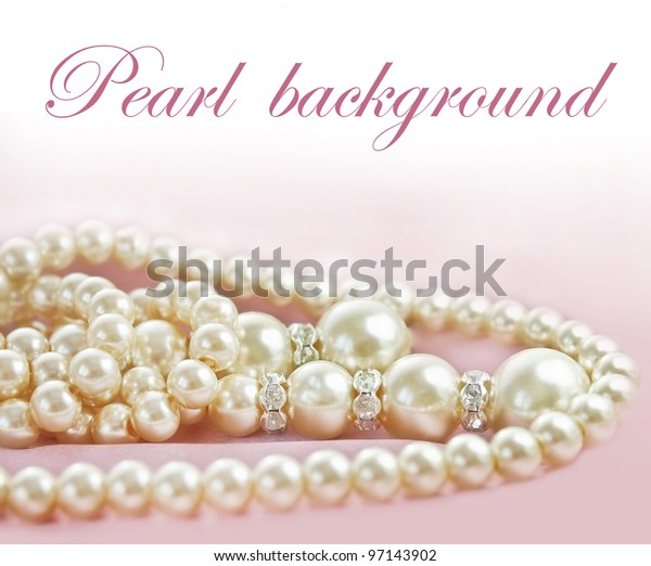 Background with Pearls  necklace on  pink silk fabric