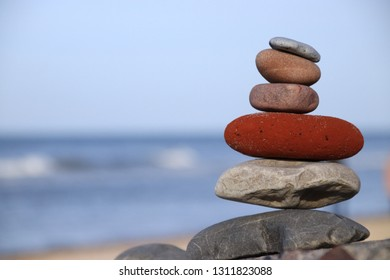 Background photo, on the background of the sea stacked in a pyramid of stones.