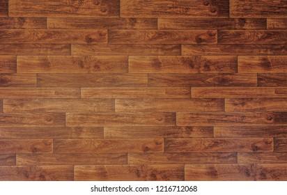 Background photo of wooden foor from above. Dark brown wooden rustic ground. Vintage floor background photo.