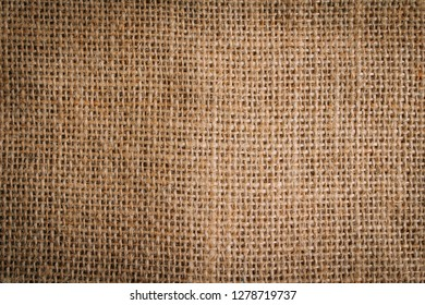 Background of a piece of burlap top view. Concept of autumn background. Toning.