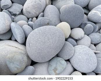 Background of pile of large stones of a rounded oval shape