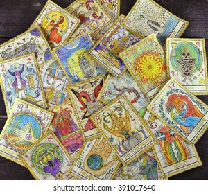 Background with pile of the tarot cards, the major arcana deck.  Fortune telling seance or black magic ritual. Scary still life with occult and esoteric symbols. Halloween or divination rite