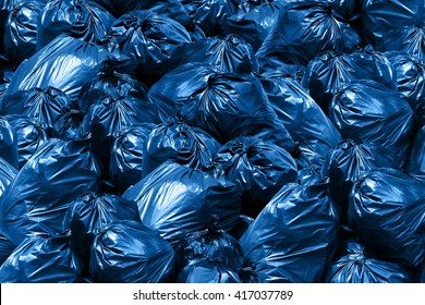 Background pile of trash bags, blue Bin,Trash, Garbage, Rubbish, Plastic Bags pile
