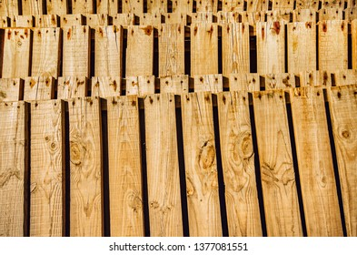 Background of piled wooden pallettes with rusty nails