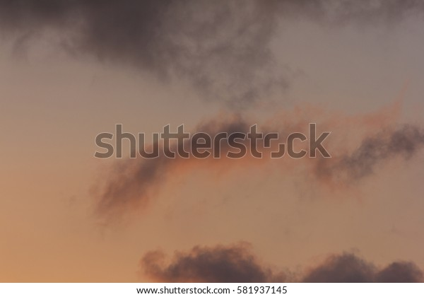 background of pink and blue clouds in the tropical sky at dawn