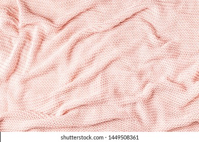Background with pink plaid, top view, copy space.