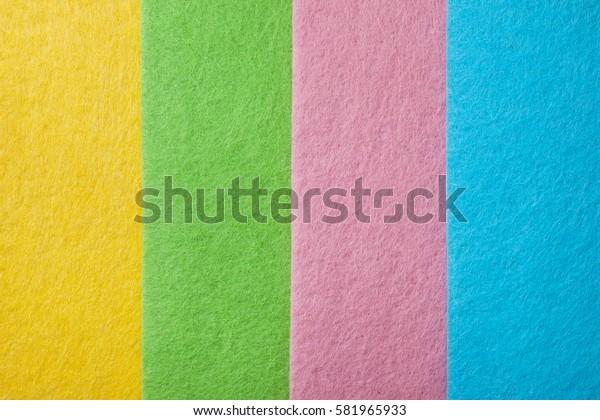 Background of pink, yellow, blue, green felt closeup
