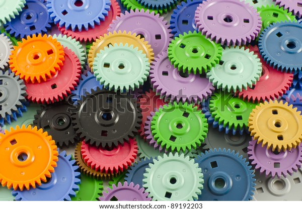 Background of the plastic different colored gears