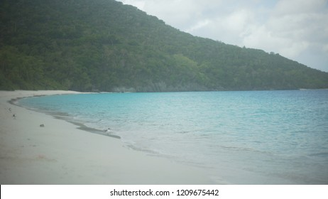 Background Plate of A cloudy day on a hilly Caribbean beach for green screen