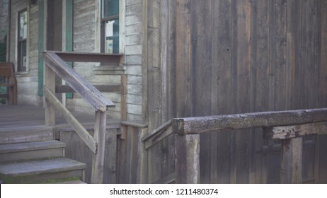 Background plate of rickety wood cabin in Auburn, California, an historical mining town. Backdrop for compositing of old wooden house with front porch and stairs. 4k