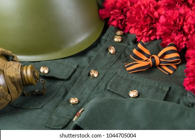 background for postcards May 9 military uniform, orange ribbon, red flowers and war items