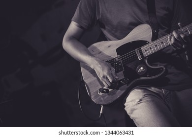 Background professional electronic guitar hero player strumming solo on stage in club, concert, music festival, new year party, air guitar competition. Play rock and teaching tutorial band perform