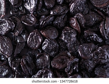 Background of prunes. Dried plum