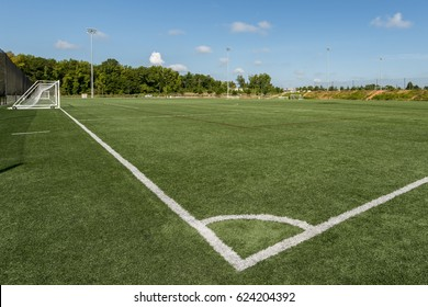 Background of a public park soccer field from the corner kick angle with a shallow depth of field