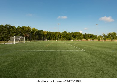 Background of a public park soccer field from the sideline angle with a shallow depth of field