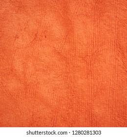 background of pumpkin orange Huun Mayan handmade paper created  by Mayan artisans throughout the Yucatan Peninsula of Mexico