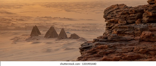 Background with the pyramids of Karima, Sudan, and the corner of the holy mountain Jebal Barkal in the foreground.