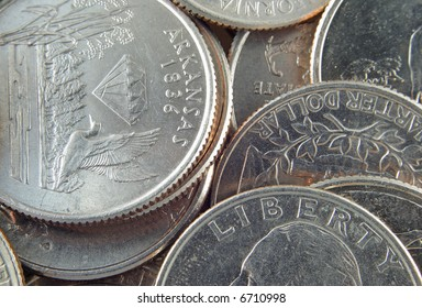 Background of quarters seen close-up.