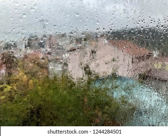 background with rain drops on window like a painting