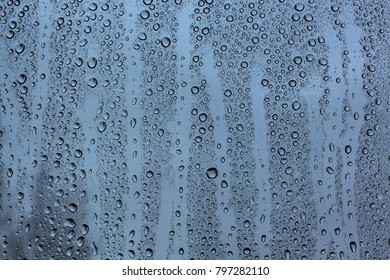 Background raindrops on the window blue