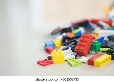Background of random coloured plastic construction blocks or brick toy. Concept of education, development and growth.