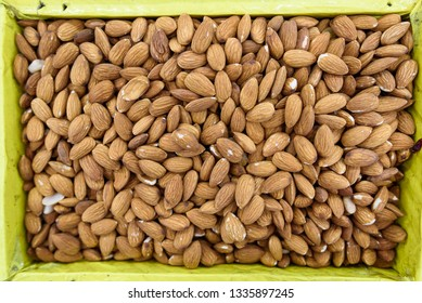 a Background of raw almonds in yellow box