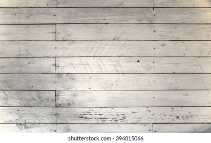 Background of raw wood panels with rough texture in beige and gray color